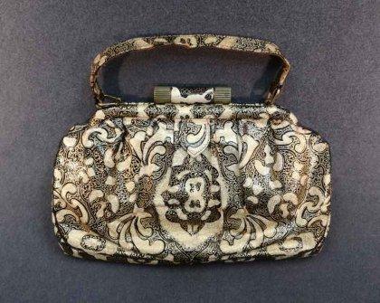 art-deco-handtasche-schwarz-beige-und-gold-gepraegt